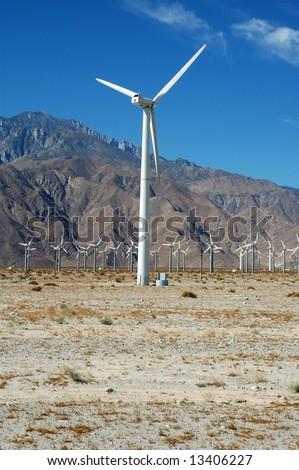 A white turbine from a California wind farm against a dark blue sky. - stock photo