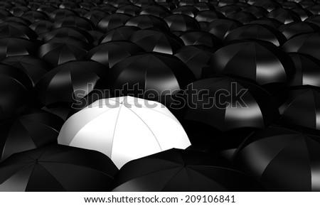 a white umbrella between many other blacks  - stock photo