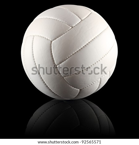 a white volleyball on black background - stock photo