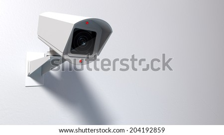 A white wireless surveillance camera with illuminated lights mounted on an isolated white wall with copy space