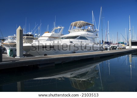 a white yacht at dock in a harbor