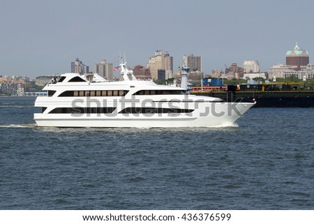 A white yacht cruising in New York Harbor