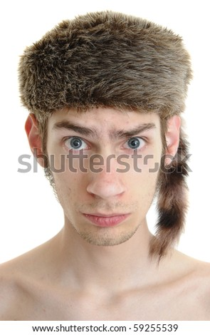 A white young male wears a raccoon hat isolated on white background - stock photo