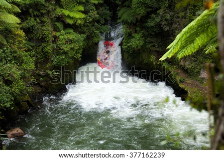 A whitewater fafters running rapid on the Kaituna River in New Zealand - stock photo