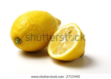 A whole and a half lemon, white background
