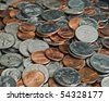 A whole bunch of American coins piled on top of one another to make this background. Shallow depth of field. - stock photo