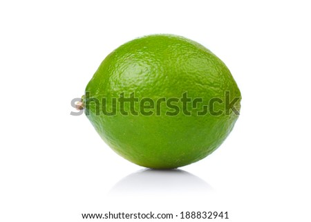 A whole fresh lime isolated on a white background. - stock photo