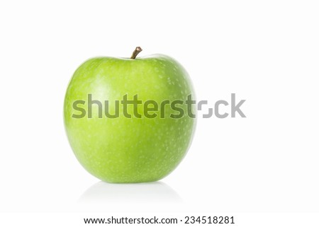 A whole green apple isolated on white background. - stock photo