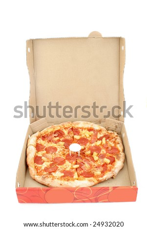a whole pizza inside delivery box on a white background