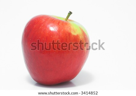 A whole red delicious apple waiting to be eaten.