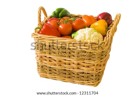 A wicker basket full of brightly colored produce. - stock photo