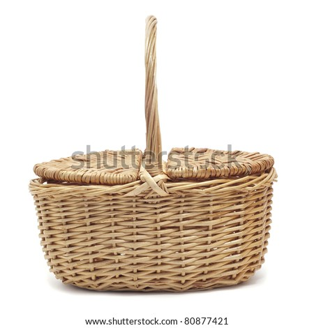 a wicker basket on a white background - stock photo