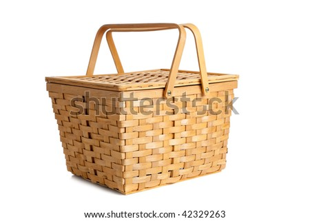 A wicker picnic basket on a white background - stock photo