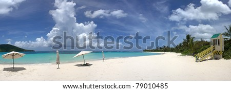 A wide angle panoramic view of the amazing clear blue Caribbean water and white sands of Flamenco beach on the Puerto Rican island of Culebra. - stock photo