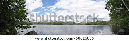 A wide angle panoramic view of the lower Saranac Lake and islands located in the upstate New York Adirondacks. - stock photo