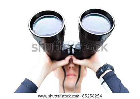 A wide angle shot of a man holding large binoculars.  Differential focus on the front of the binoculars.  Isolated on white. - stock photo