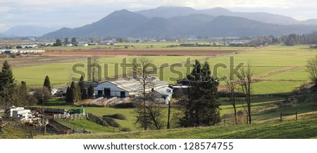 wide angle view of a dairy farm in a valley/Valley Dairy Farm/A wide