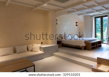 A wide angle view of a hotel room - stock photo