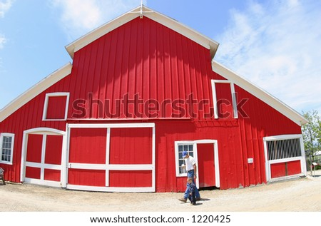 A wide-angle view of a red barn in Southern California. - stock photo