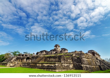 A wide angle view of showing the entire palace at the Mayan ruins of Palenque in Chiapas, Mexico - stock photo