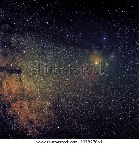 A wide angle view of the Antares Region of the Milky Way. The colorful Antares Region meets the dark nebula of the Milky Way. - stock photo