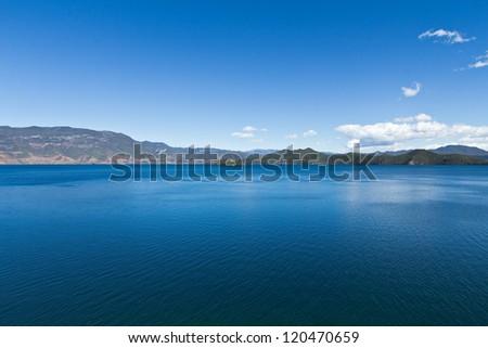 A wide deep blue lake - stock photo
