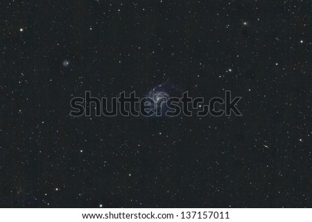 A wide field view of M101, also know as The Pinwheel Galaxy - stock photo