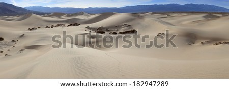 a wide panoramic view of sand dunes in Death Valley  - stock photo