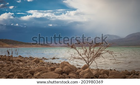 A wide shot of an approaching monsoon over Lake Roosevelt in Arizona. - stock photo