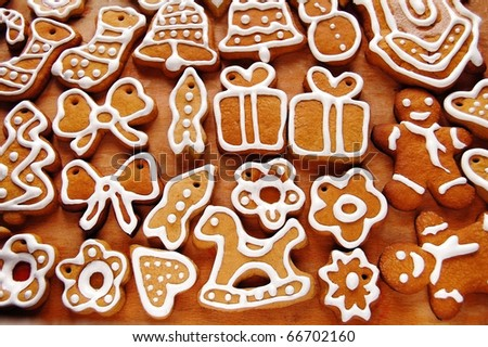 A wide variety of Christmas cookies. All brightly colored cookies. Isolated on white background. - stock photo