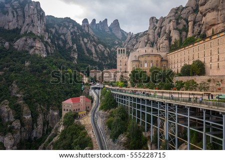 A wide view of the abbey on the Montserrat Mountain with her peaks in the background. Catalonia, Spain.