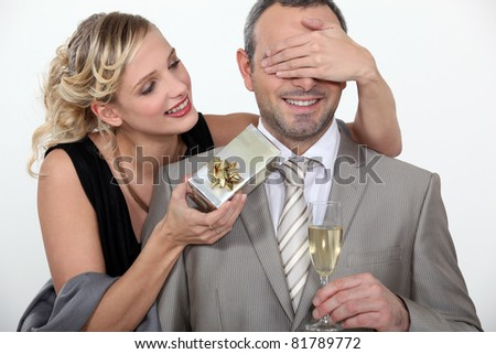a wife making a surprise to her husband - stock photo