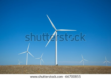 A wind farm in rolling foothills
