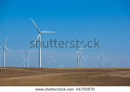 A wind farm in rolling foothills - stock photo