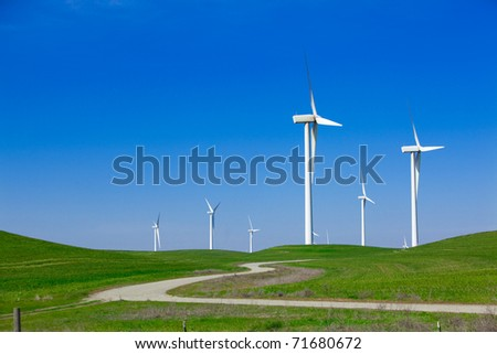 A Wind Farm with blue sky and clouds - stock photo