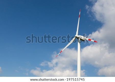 A wind turbine for clean energy production with blue sky