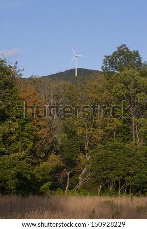 A wind turbine on a mountain in Western Massachusetts. - stock photo