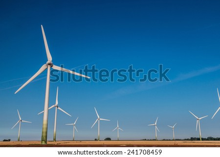 A Wind Turbine on a Wind Farm  in summer day - stock photo