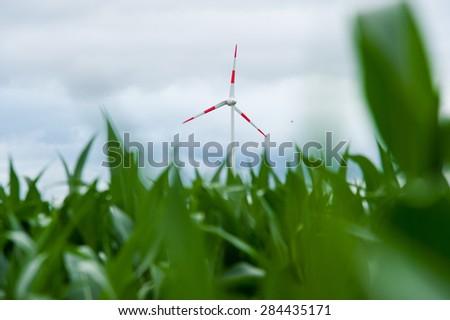 A wind wheel on a field. - stock photo