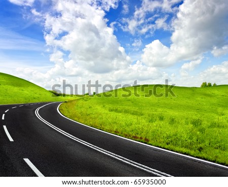 A winding mountain road - stock photo