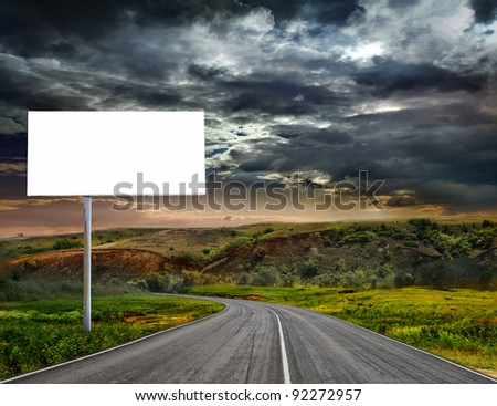 A winding paved country road - stock photo