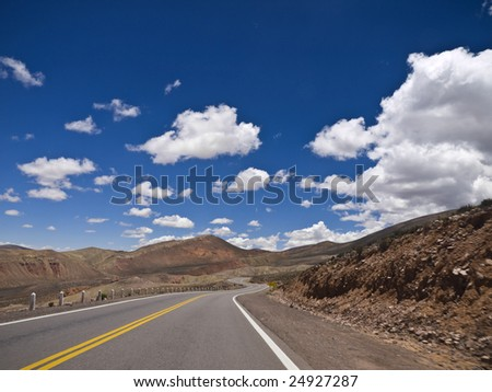 A winding road ahead. Small motion blur. - stock photo