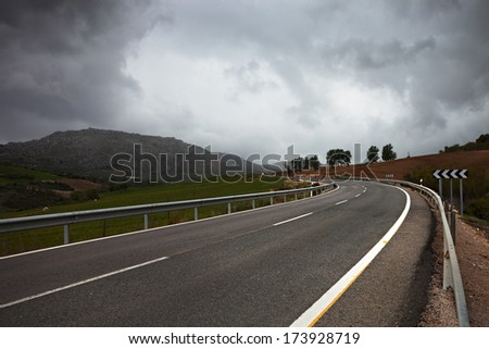 a winding  road through hills. Andalusia, Spain. - stock photo