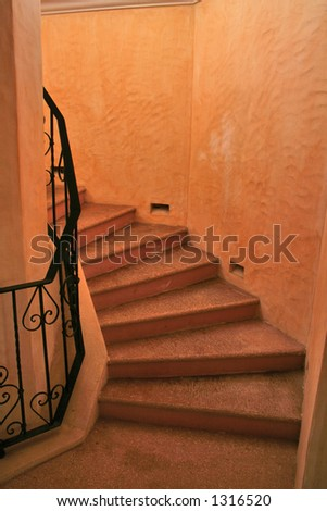 A winding spiral staircase - stock photo