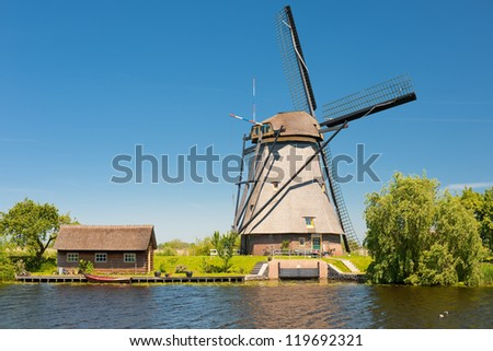 A windmill at Kinderdijk in May. - stock photo