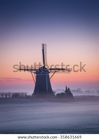 A windmill at Wilsveen, the Netherlands in the early morning winter light. - stock photo