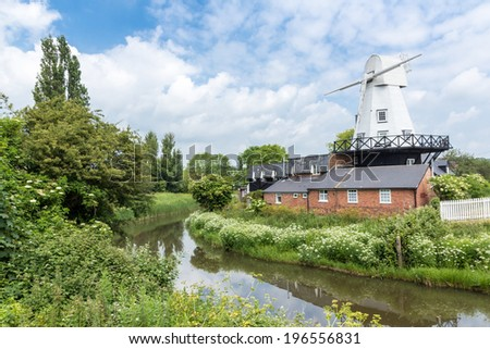 A windmill by the river Rother, seen in Rye, Kent, UK - stock photo