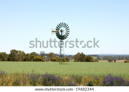 A windmill on a farm, near Young, New South Wales, Australia - stock photo