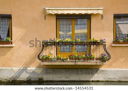 A window and balcony in the south of France.