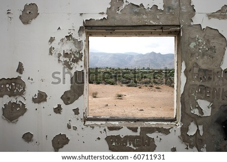 a Window frame of old building with landscape - stock photo